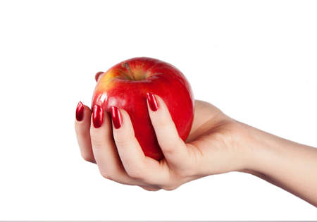 parable: Fresh red apple in hand on a white background Stock Photo