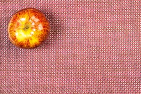 claret: apple on a claret background Stock Photo