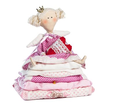 Princess and the Pea holding a heart on a white background