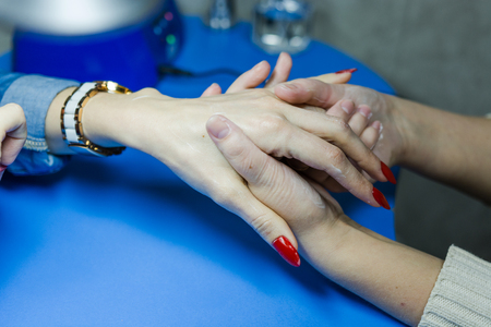 Beautiful manicure and natural nails with gel polish. Attractive modern nail art design.