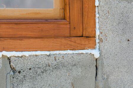 Construction foam. Foam of a stroiteln at a window. Dry foam at a window.