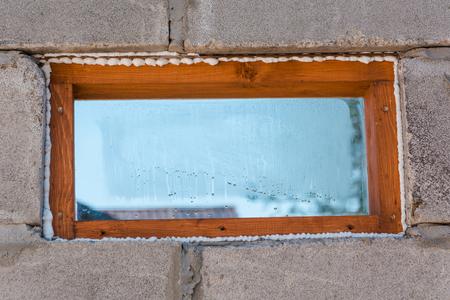insulated: Construction foam. Foam of a stroiteln at a window. Dry foam at a window.