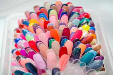 Palette for varnish. A color palette for varnish. A varnish color palette in beauty shop. Color palette.