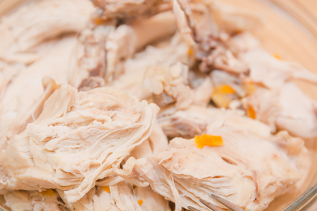 Boiled meat of chicken. Meat of a turkey. The chicken cut on pieces.