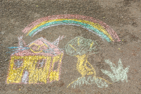 Children's drawings on the road. Chalk drawings on the asphalt.
