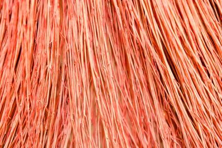 Background broom close up. Broom texture Red broom. Close broom. Stock Photo