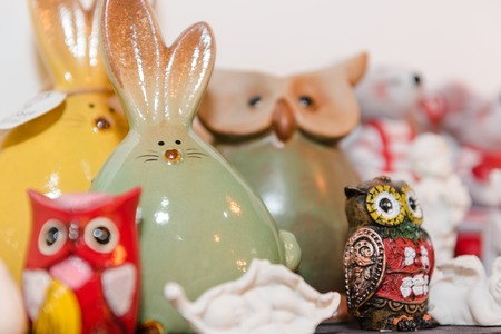 Ceramic toys. Figurines made of ceramics. Traditional handmade ceramic gift toy. Clay colorful toys sold in the store