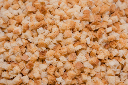 Background crackers. The texture of dry bread. Rusks close up. Finely chopped bread