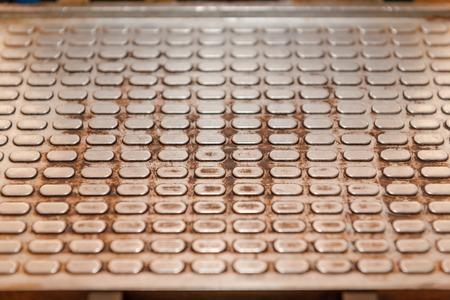 Metallic background. The texture of the metal. Metal squares. Corrugated metal. Old metal. Stock Photo