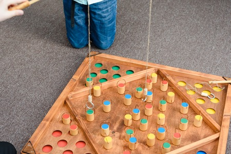 Kids games with colored shapes. Catch a wooden figure on the bait. Place the figures in places. Educational games for children