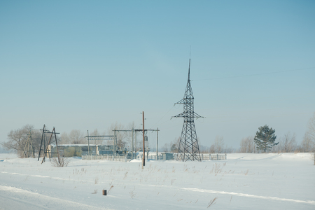 A small power station. Electricity by wire. Dangerous job. Power plants in winter Stok Fotoğraf - 116783596