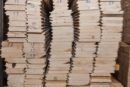 Lumber butts. Boards clad in piles. Euro race, blockhouse, timber emitation. A lot of lumber. Stok Fotoğraf - 116783607
