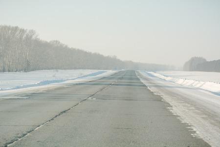 Asphalt road in winter. Winter landscapes. Russia in the winter. Road to field Stok Fotoğraf