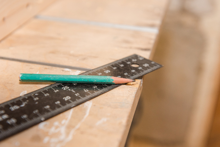 Measure tree with a ruler. Measuring tools in the carpentry workshop. Joinery. Draw on wooden details. Pencil and ruler. Measure length.