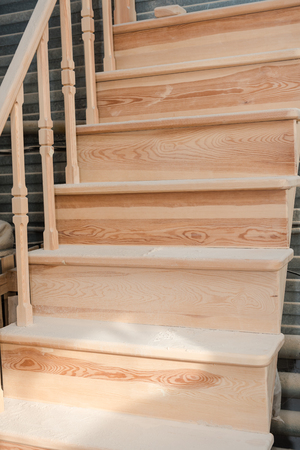Wooden staircase Making stairs. New staircase. Joiner's product. Stok Fotoğraf - 116783556