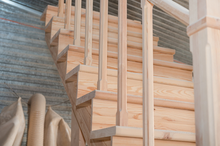 Wooden staircase Making stairs. New staircase. Joiners product.