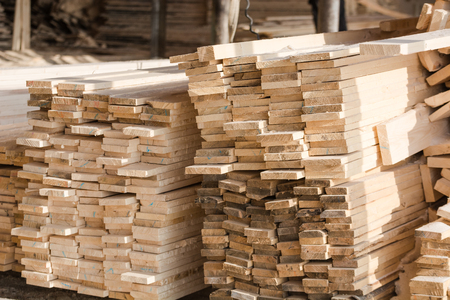 Logs sawn on the boards. Sawing boards. A lot of lumber. Lumber warehouse Stok Fotoğraf - 116783308