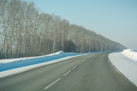 Winter road among the fields. The road among the fields. Snow fields. Winter landscape. Stok Fotoğraf - 116783260