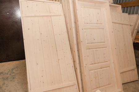 Wooden doors in stock. A lot of wooden doors. Joinery. Carpentry workshop.