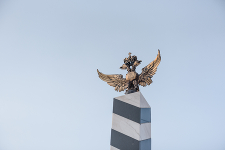 Bronze eagle, Metal of a bird. Attraction of bronze. Milestone with an eagle. The plan of the eagle.