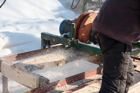 Machine for cutting wood on the boards. Sawmill. production of boards. Wood processing factory. sawing wood. Stok Fotoğraf