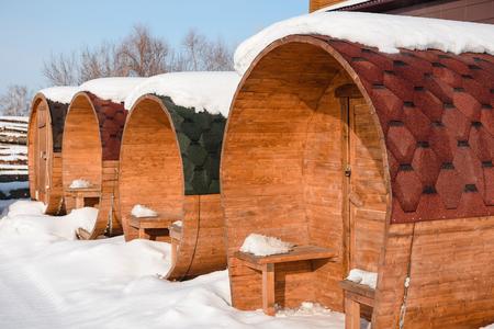 Round bath is on the street. Round bath in winter. Ready baths on a power-saw bench. Build a bath