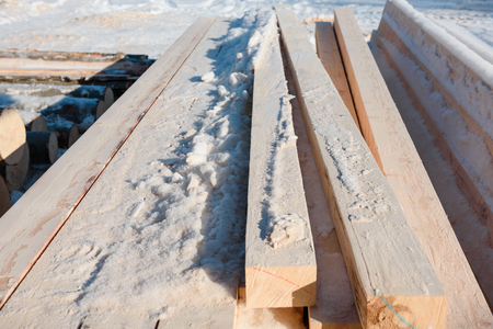 Timber at work. Lumber stockpiled. The boards are stacked. Boards for sale in stock. Lumber. Stok Fotoğraf