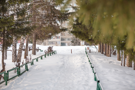 Urban winter landscape of Russia. City under the snow. Winter on the streets. City in Siberia. A lot of snow on the street. Stok Fotoğraf