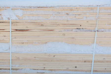 View of the stack of boards. Boards closeup. Wood texture. Background tree.