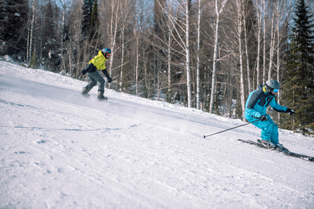 Snowboarding from a snowy mountain. Active lifestyle. Health. Ski resort.