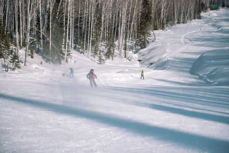 A skier rides from a high mountain. Ski resort. Active lifestyle. Health. Russian sport