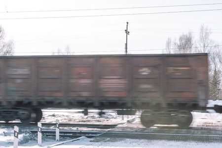 Train in the winter. Train in the winter. Train at speed. Movement on the way.