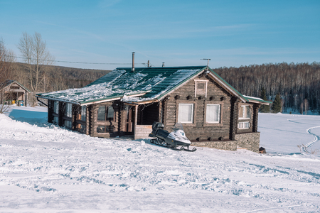 Village in the winter. Houses in Siberia under the snow. Buildings in the snow. Countryside in winter. Winter resort Stok Fotoğraf