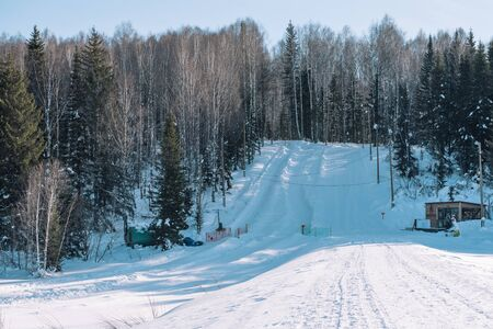 Slide for tubing. Ski Track. Tubing track. Mount for stumbling on buns. Winter slide.