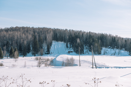 Village in the winter. Houses in Siberia under the snow. Buildings in the snow. Countryside in winter. Stok Fotoğraf