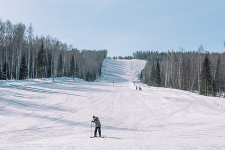 Skiers ride from the mountain. Ski resort. Winter in Siberia. Winter landscape. Beautiful nature. Extreme winter sport