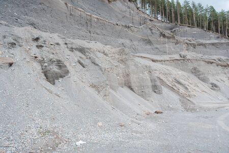 stone quarry. mine stone. stone quarry under the forest. pine forest over a stone quarry. economy. Zdjęcie Seryjne