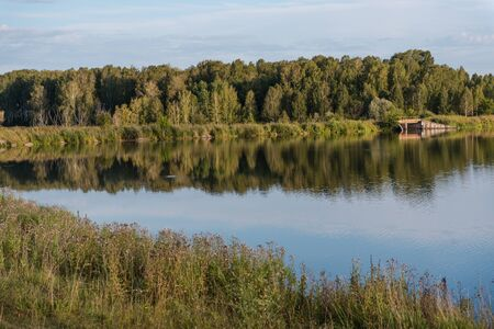 small lake in the forest. lake in Russia. to fish on the lake. beautiful landscape. admire the lake. look at the water. Stock Photo