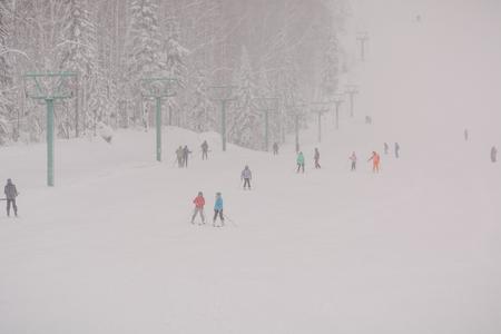 Zarinsk, Russia - December 14, 2019: Many people are skiing. Ski resort Archivio Fotografico - 136210791