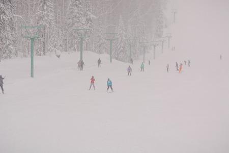 Zarinsk, Russia - December 14, 2019: Many people are skiing. Ski resort Archivio Fotografico - 136210790
