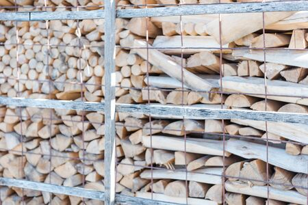 Firewood is lying. Firewood background. Firewood close-up. Wood. Fuel. Burn wood. Birch wood. Use the stove. Stacked. Chop wood. Agriculture. Reklamní fotografie