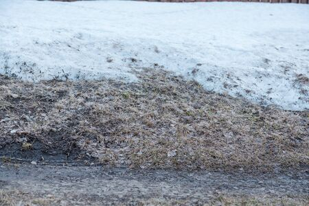 Spring is on the street. Dirty snow. Snow melts. Spring weather. Close up of dirty snow.