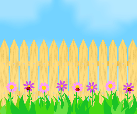 Grass and flowers before the fence.
