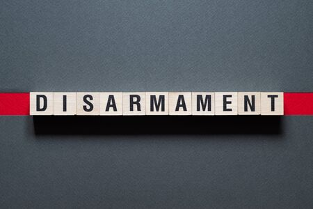 Disarmament word concept on cubes 版權商用圖片