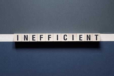 Inefficient word concept on cubes Stockfoto