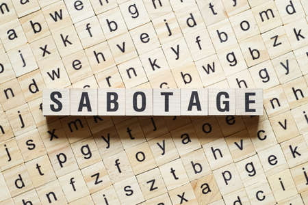 Sabotage word concept on cubes.