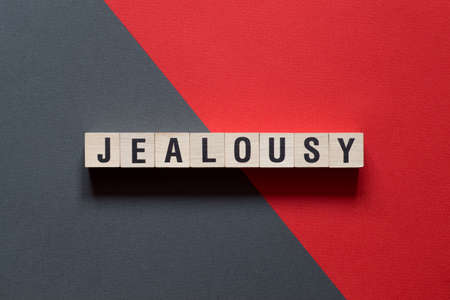 Jealousy word concept on cubes. Imagens