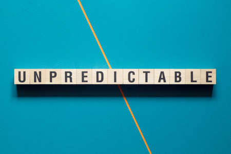 Unpredictable word concept on cubes.