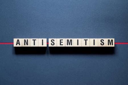 Anti - Semitism word concept on cubes.