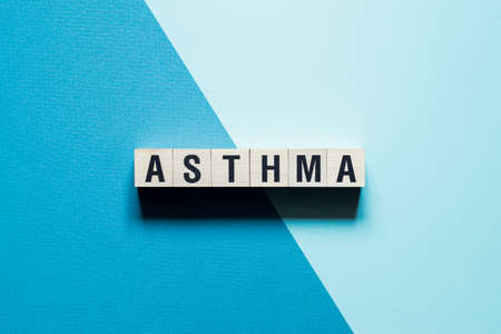 Asthma word concept on cubes.
